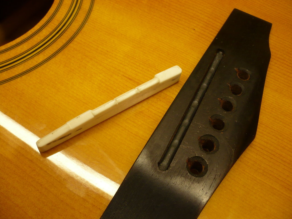 Piezo under guitar bridge