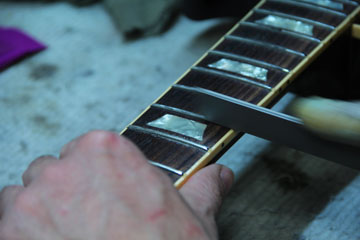 Fret working